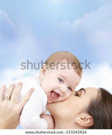 family, child and happiness concept - happy mother with baby - stock photo