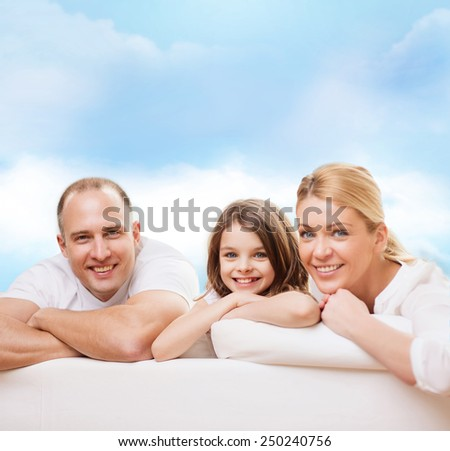 family, childhood and people - smiling mother, father and little girl over blue sky background - stock photo
