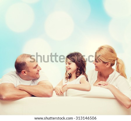 family, childhood, holidays and people - smiling mother, father and little girl over blue lights background