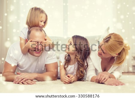 family, childhood, people and home concept - smiling parents with two little girls having fun at home - stock photo