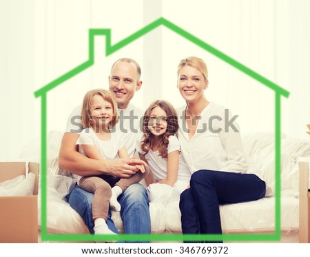 family, children, accommodation and home concept - smiling parents and two little girls at home behind green house symbol - stock photo