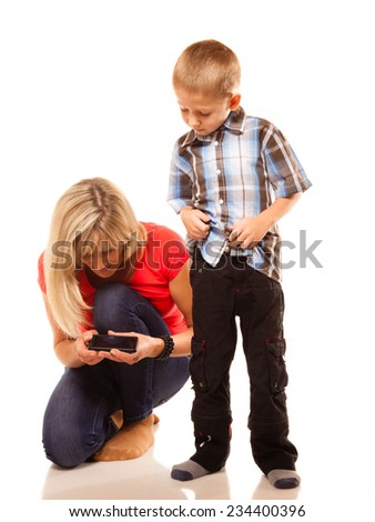 Family, children, parenthood, technology and internet concept. Mother and son playing video game on smartphone isolated on white