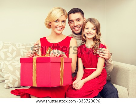 family, christmas, x-mas, winter, happiness and people concept - happy family opening - stock photo