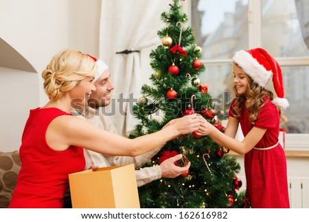 People Decorating preparing christmas tree stock images, royalty-free images