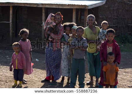 family color portrait of black kids in africa, december 2015, oromia state, ethiopia