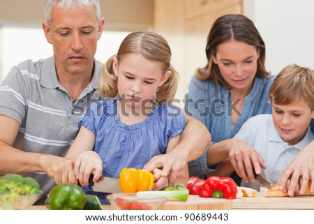 Family cooking together at home - stock photo
