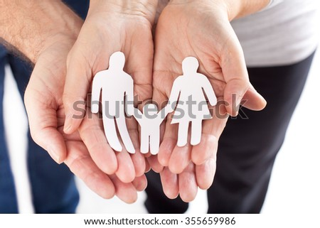 family cupped hands showing paper man family