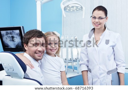 Family doctor in the dental office - stock photo