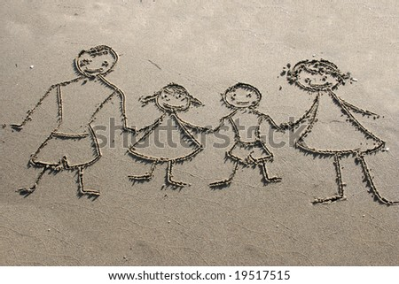 Family. Drawing on the sand - stock photo