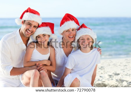 Family during Christmas day at the beach - stock photo