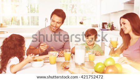 Family eating healthy breakfast in kitchen - stock photo