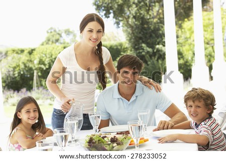 Family eating outisde together - stock photo
