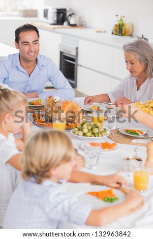 Family eating thanksgiving dinner together - stock photo