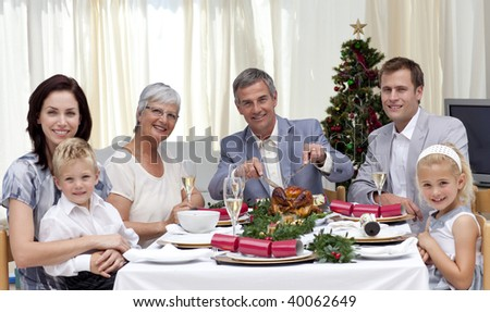 Family eating turkey in Christmas Eve Dinner at home