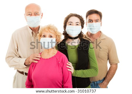 Family - elderly parents, their adult son, and teen granddaughter - wearing surgical masks to protect from an epidemic. - stock photo