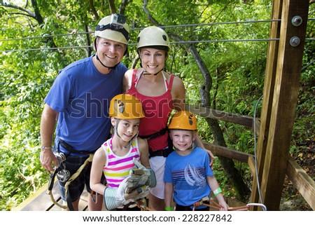 Family enjoying a Zipline Adventure on Vacation - stock photo