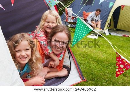 Family Enjoying Camping Holiday On Campsite  - stock photo