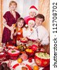 Family Enjoying Christmas Meal At Home - stock photo
