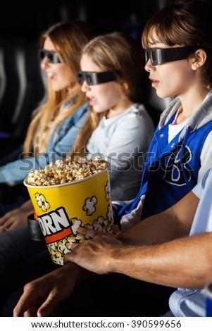 Family Enjoying 3D Movie In Theater - stock photo
