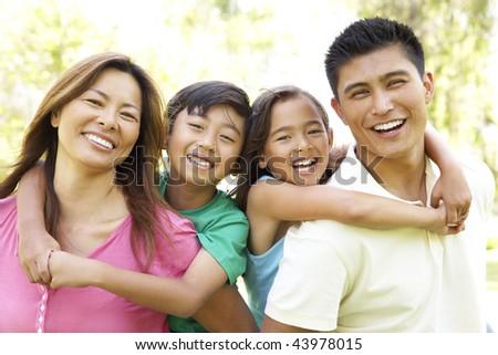 Family Enjoying Day In Park - stock photo