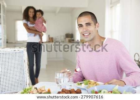 Family Enjoying Meal Together At Home - stock photo