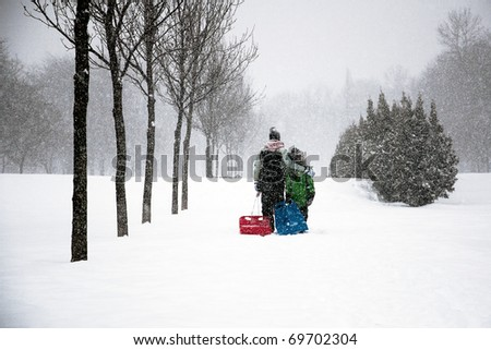Family Enjoying Winter - stock photo