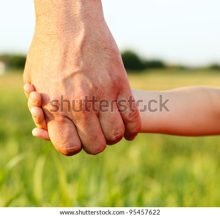 family father and child son hands nature outdoor - stock photo