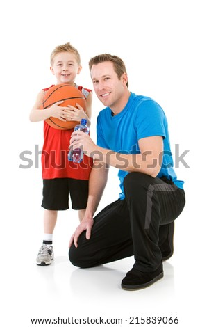 Family: Father and Son Take a Break From Basketball  - stock photo