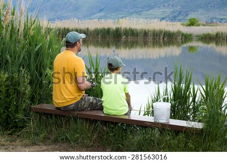 Family fishing on Bountiful Pond (Lake), Utah, US - stock photo