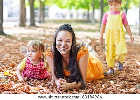 Family for a walk in autumn - stock photo