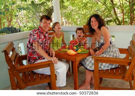 Family fruit breakfast on the terrace - stock photo