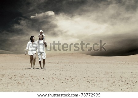 family fun in desert on a sunny day - stock photo