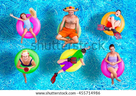 Family fun in the swimming pool in summer with a father, mother, grandmother, boys and a girl floating on colorful inner tubes in their swimsuits in various positions, conceptual image
