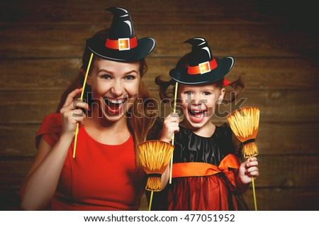 Family fun mother and child daughter having fun and celebrate Halloween in witch costume