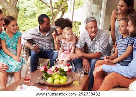 Family gathering in a conservatory - stock photo
