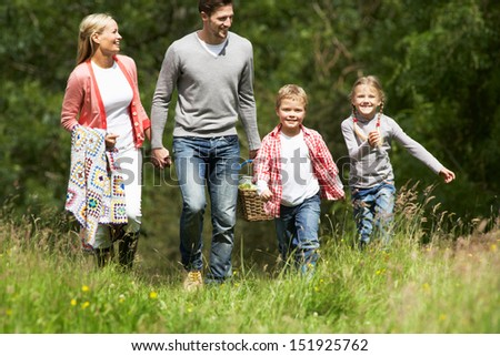 Family Going On Picnic In Countryside - stock photo