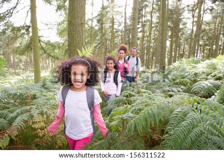 Family Group Hiking In Woods Together - stock photo