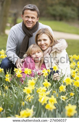 Family Group In Daffodils - stock photo