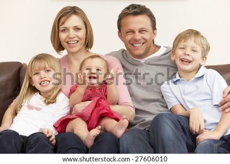 Family Group On Sofa - stock photo