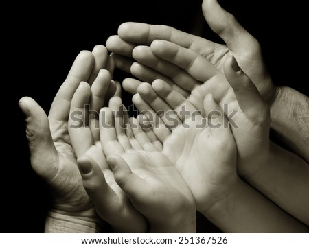 family hands, a symbol of unity. - stock photo