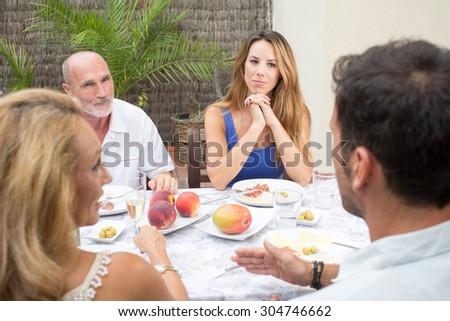 family has breakfast outside - stock photo