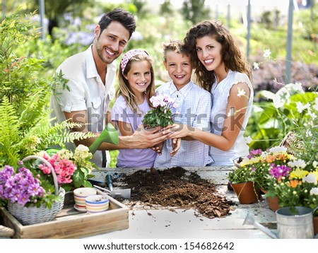 family have fun in the work of gardening - stock photo