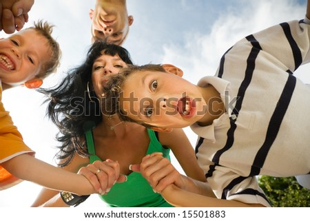 Family having a lot of fun - a metaphor for family love, support, and unity (focus on the boy in front!) - stock photo