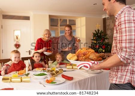 Family having Christmas dinner - stock photo