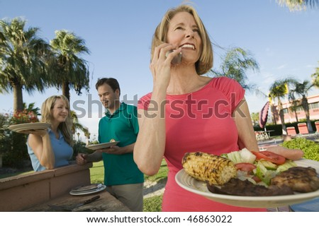 Family Having Cookout - stock photo
