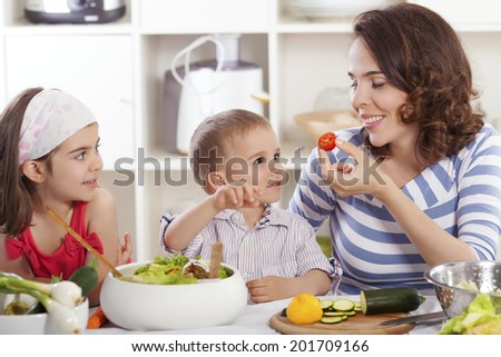 Family having fun making healthy food - stock photo