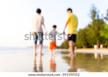 Family having fun on a sandy beach, Happy beautiful family - stock photo