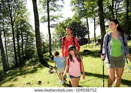 Family having fun on a trekking day - stock photo