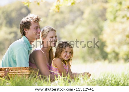 Family having picninc in countryside - stock photo