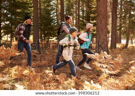 Family hiking through a forest, California, USA - stock photo